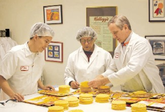 No waffling on quality: Maggie Lewis (left) and Roger Dennis work on refining Eggo waffles in the San Jose, Calif., facility.