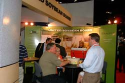 With beer on tap just before quitting time, United Soybean Board's booth was popular late in the day.
