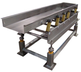 The Tex-Flex Excited Base Vibratory Conveyor utilizes a single, maintenance-free rotary electric vibrator.