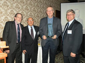 (Left to right): FDA Deputy Director Michael Landa, NCFST founder and executive advisory board member Dr. Darsh Wasan, Dr. Paul Hall, AIV Microbiology & Food Safety Consultants LLC and NCFST executive advisory board member Dr. Jonathan DeVries, General Mills, pose following the 2009 NCFST Food Safety Award to Hall in March.